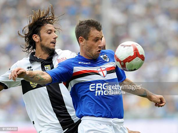 Antonio Cassano of UC Sampdoria competes for the ball with Cristian Zaccardo of Parma FC during the Serie A match between UC Sampdoria and Parma FC...