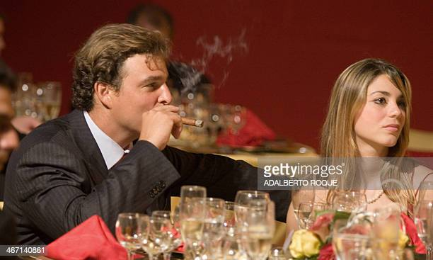 Antonio Castro doctor and son of the Cuban President Fidel Castro smokes a cigar 03 March 2007 during the final dinner of the IX Festival of Cuban...