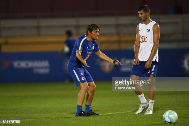 Antonio Conte and Alvaro Morata of Chelsea during a training session at Singapore American School on July 23 2017 in Singapore