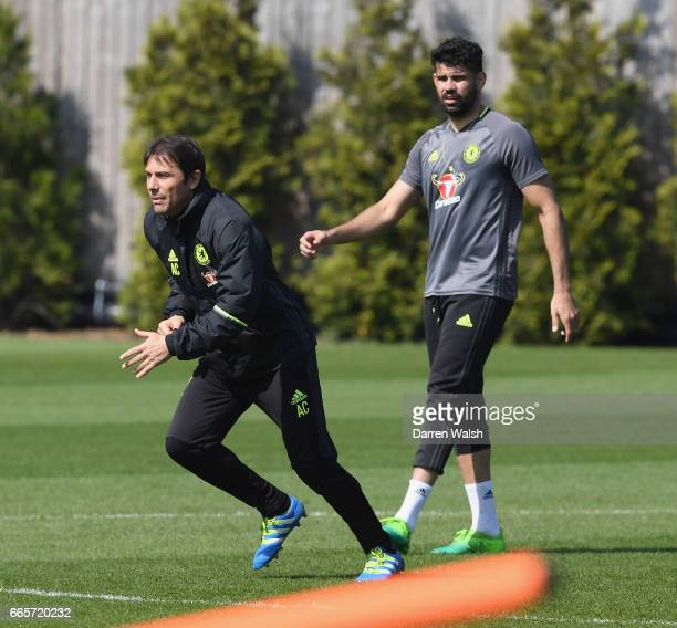 Antonio Conte and Diego Costa of Chelsea during a training session at Chelsea Training Ground on April 7 2017 in Cobham England