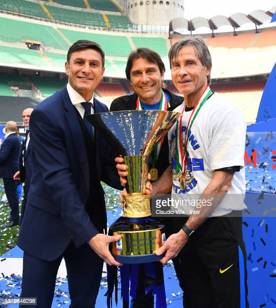 """Antonio Conte , Gabriele Oriali and Javer Zanetti of FC Internazionale pose with the trophy for the victory of """"scudetto"""" at the end of the last..."""