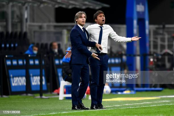 Antonio Conte head coach of FC Internazionale and Gabriele Oriali react during the Serie A football match between FC Internazionale and AC Milan AC...