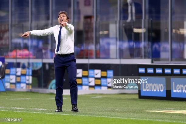 Antonio Conte head coach of FC Internazionale gestures during the Serie A match between FC Internazionale and Ac Milan Ac Milan wins 21 over Fc...