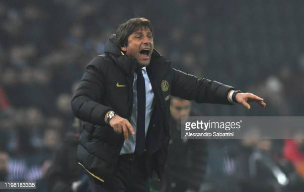 Antonio Conte head coach of FC Internazionale issues instructions to his players during the Serie A match between Udinese Calcio and FC...