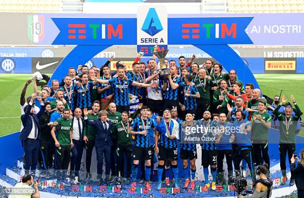 Antonio Conte, Head Coach of FC Internazionale lifts the Serie A trophy as his players celebrate after the Serie A match between FC Internazionale...