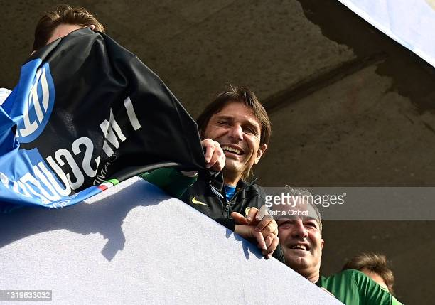 Antonio Conte, Head Coach of FC Internazionale reacts towards the fans who are gathered outside the ground after the Serie A match between FC...