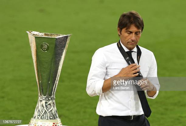 Antonio Conte Head Coach of Inter Milan is seen next to the UEFA Europa League Trophy with his runners up medal following his team's defeat in the...