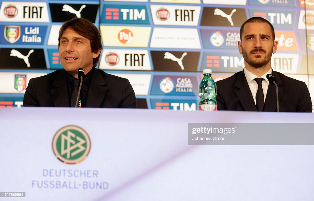 Antonio Conte (L), head coach of Italy and Leonardo Bonucci address the media ahead of the international friendly match between Germany and Italy at Allianz Arena on March 28, 2016 in Munich, Germany.