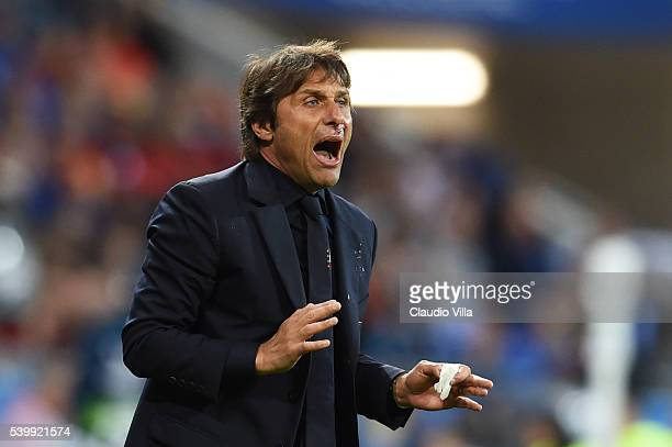 Antonio Conte head coach of Italy gestures during the UEFA EURO 2016 Group E match between Belgium and Italy at Stade des Lumieres on June 13 2016 in...