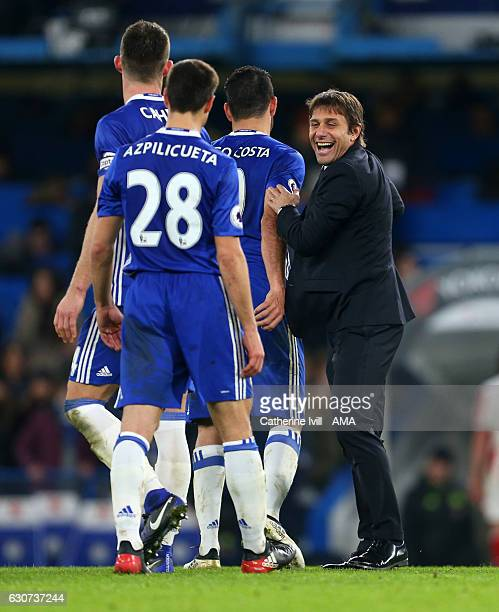 Antonio Conte manager / head coach of Chelsea celebrates with Diego Costa Gary Cahill and Cesar Azpilicueta of Chelsea after the Premier League match...