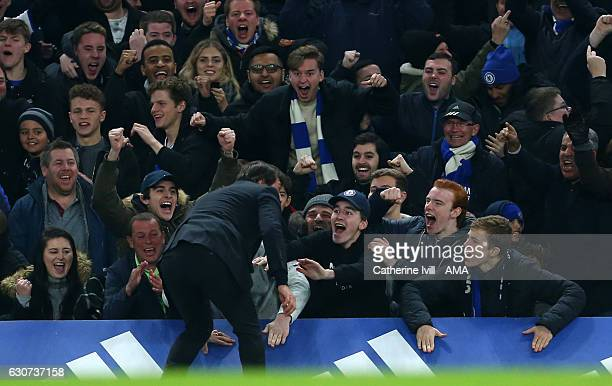Antonio Conte manager / head coach of Chelsea celebrates with the fans during the Premier League match between Chelsea and Stoke City at Stamford...