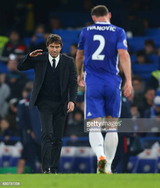 Antonio Conte manager / head coach of Chelsea heads towards Branislav Ivanovic of Chelsea after the Premier League match between Chelsea and Stoke...