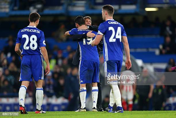 Antonio Conte manager / head coach of Chelsea hugs Diego Costa of Chelsea after the Premier League match between Chelsea and Stoke City at Stamford...