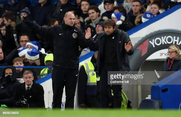 Antonio Conte manager / head coach of Chelsea puts his hands up as he talks to fourth official Bobby Madley during the Premier League match between...