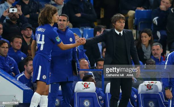 Antonio Conte manager / head coach of Chelsea shakes the hand of Ethan Ampadu of Chelsea before he comes on to make his debut during the Carabao Cup...