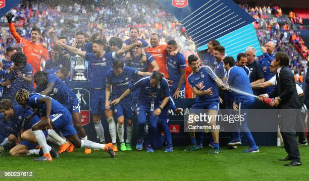 Antonio Conte manager / head coach of Chelsea sprays champagne as the team celebrate after The Emirates FA Cup Final between Chelsea and Manchester...