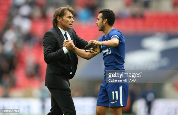Antonio Conte manager head coach of Chelsea with Pedro of Chelsea during the Premier League match between Tottenham Hotspur and Chelsea at Wembley...