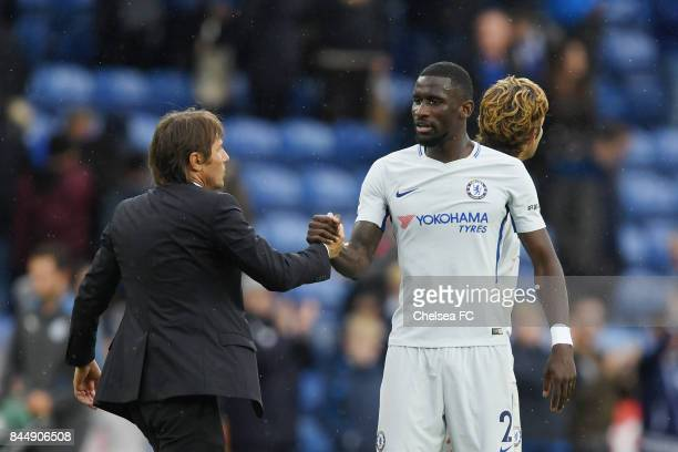 Antonio Conte Manager of Chelsea and Antonio Rudiger of Chelsea embrace after the Premier League match between Leicester City and Chelsea at The King...