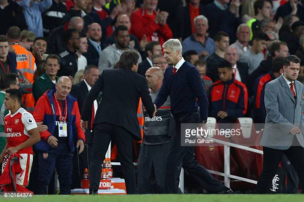 Antonio Conte Manager of Chelsea and Arsene Wenger Manager of Arsenal shake hands after the final whistle during the Premier League match between...