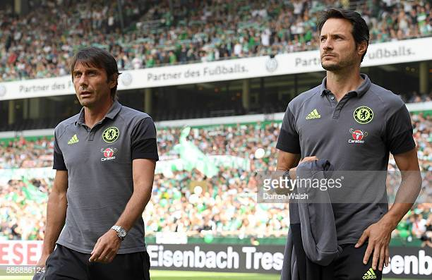 Antonio Conte Manager of Chelsea and Carlo Cudicini of Chelsea walk out onto the pitch during the PreSeason Friendly match between Werder Bremen and...