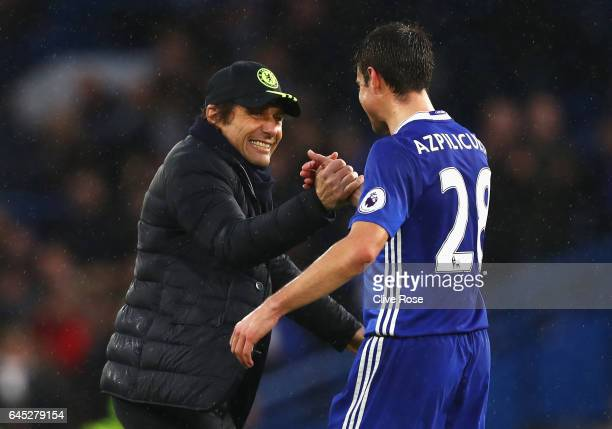 Antonio Conte Manager of Chelsea and Cesar Azpilicueta of Chelsea embrace after the Premier League match between Chelsea and Swansea City at Stamford...