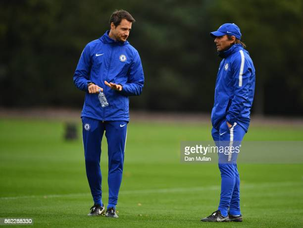 Antonio Conte Manager of Chelsea and coach Carlo Cudicini in discussion during a Chelsea training session on the eve of their UEFA Champions League...