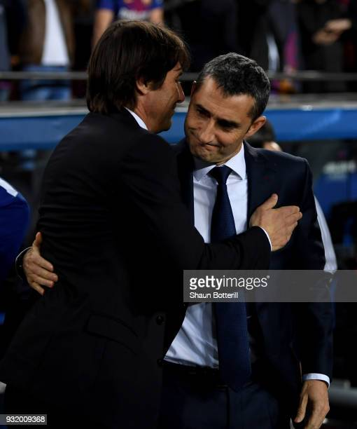 Antonio Conte Manager of Chelsea and Ernesto Valverde coach of Barcelona embrace prior to the UEFA Champions League Round of 16 Second Leg match FC...