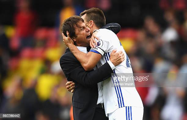Antonio Conte Manager of Chelsea and John Terry of Chelsea celebrate after the final whistle during the Premier League match between Watford and...