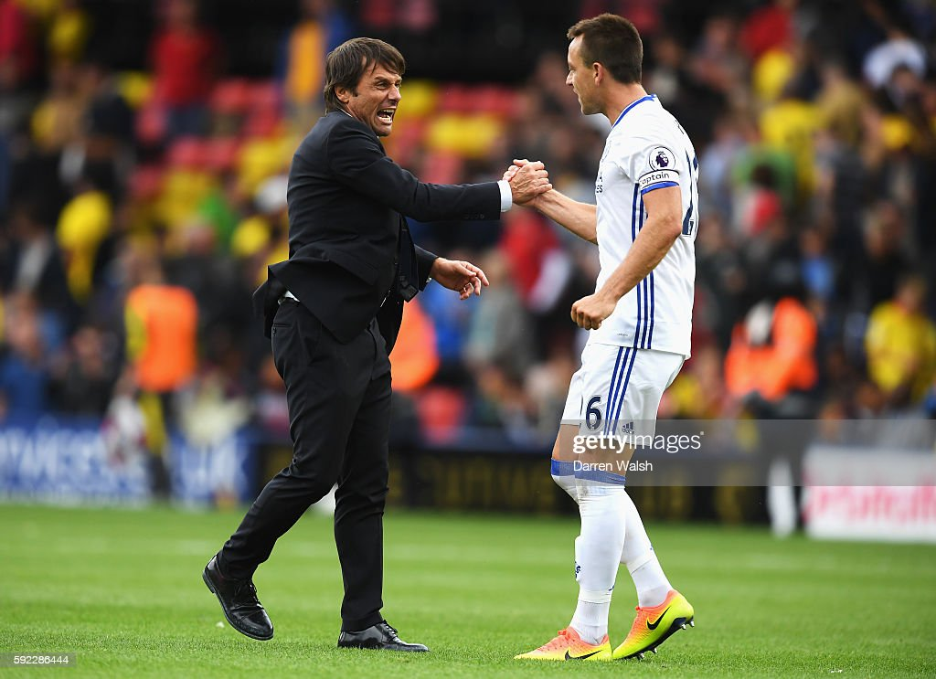 Antonio Conte, Manager of Chelsea and John Terry of Chelsea celebrate after the final whistle during the Premier League match between Watford and Chelsea at Vicarage Road on August 20, 2016 in Watford, England.
