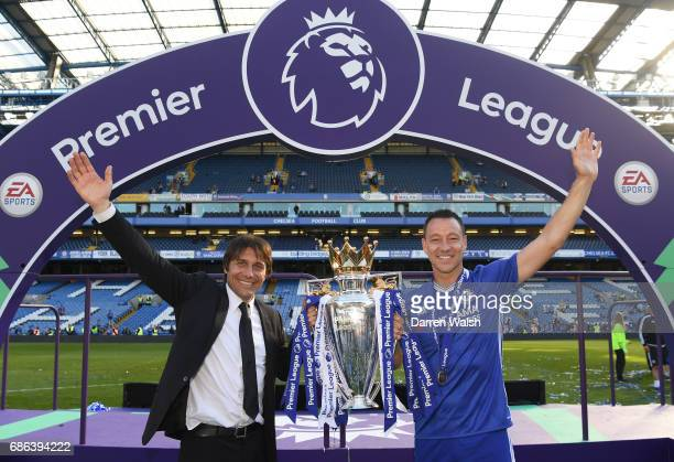 Antonio Conte Manager of Chelsea and John Terry of Chelsea pose with the Premier League Trophy after the Premier League match between Chelsea and...