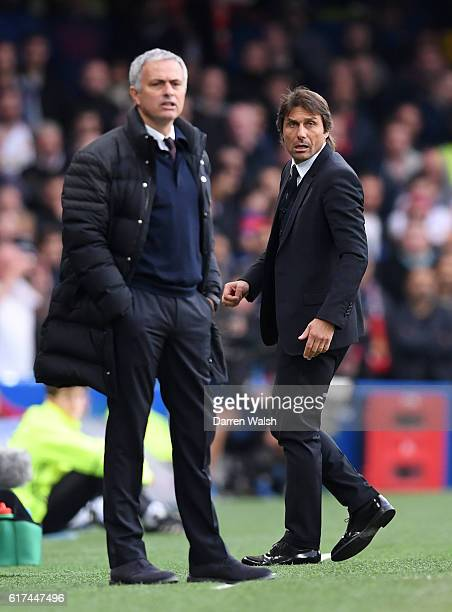 Antonio Conte Manager of Chelsea and Jose Mourinho Manager of Manchester United look on during the Premier League match between Chelsea and...