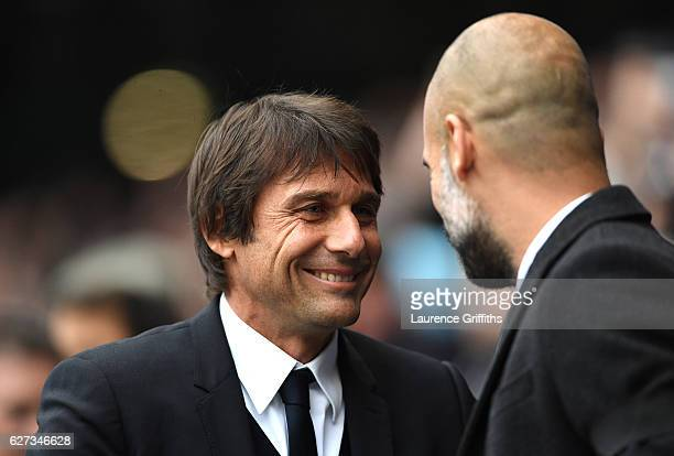 Antonio Conte Manager of Chelsea and Josep Guardiola Manager of Manchester City greet prior to the Premier League match between Manchester City and...