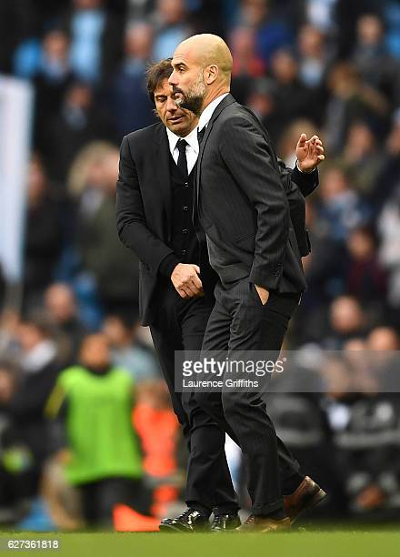 Antonio Conte Manager of Chelsea and Josep Guardiola Manager of Manchester City shake hands after the Premier League match between Manchester City...