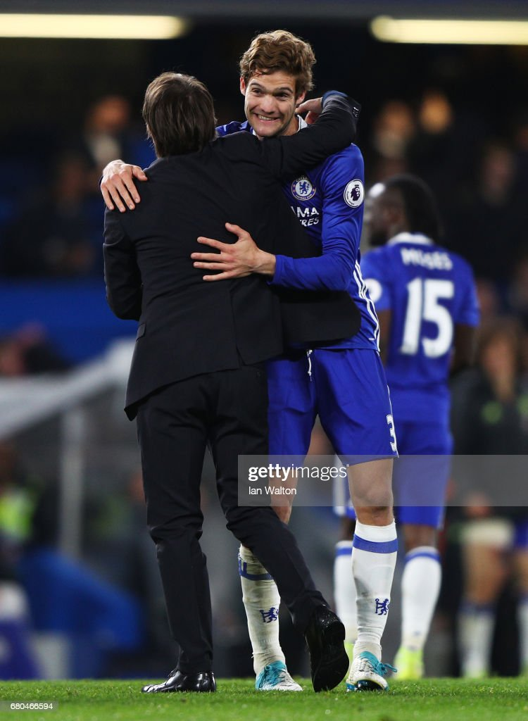 Antonio Conte, Manager of Chelsea and Marcos Alonso of Chelsea celebrate following the Premier League match between Chelsea and Middlesbrough at Stamford Bridge on May 8, 2017 in London, England.