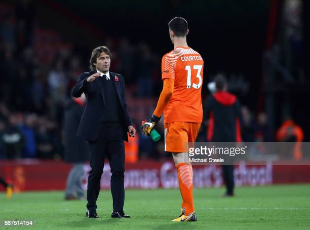 Antonio Conte Manager of Chelsea and Thibaut Courtois of Chelsea shake hands after the Premier League match between AFC Bournemouth and Chelsea at...