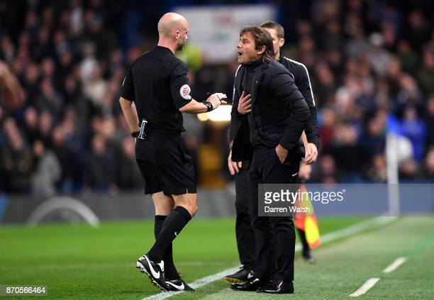 Antonio Conte Manager of Chelsea argues with referee Anthony Taylor during the Premier League match between Chelsea and Manchester United at Stamford...