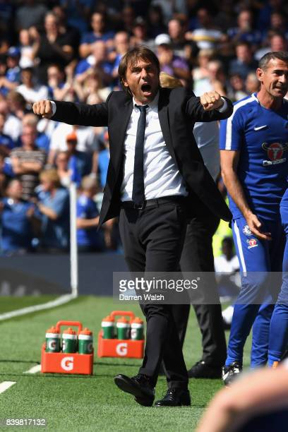 Antonio Conte Manager of Chelsea celebrates his sides second goal during the Premier League match between Chelsea and Everton at Stamford Bridge on...