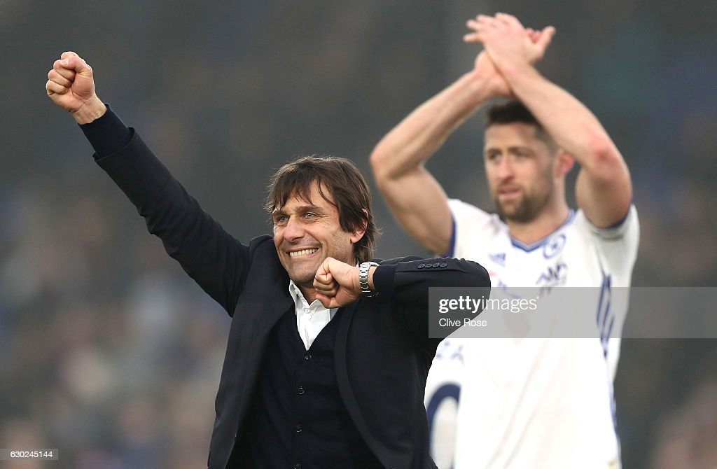 Antonio Conte, Manager of Chelsea (C) celebrates his sides win after the game during the Premier League match between Crystal Palace and Chelsea at Selhurst Park on December 17, 2016 in London, England.