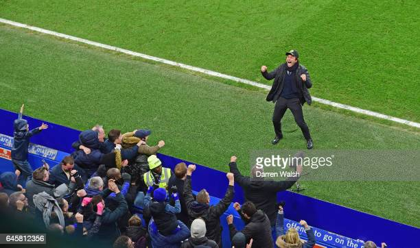 Antonio Conte manager of Chelsea celebrates in front of fans during the Premier League match between Chelsea and Swansea City at Stamford Bridge on...