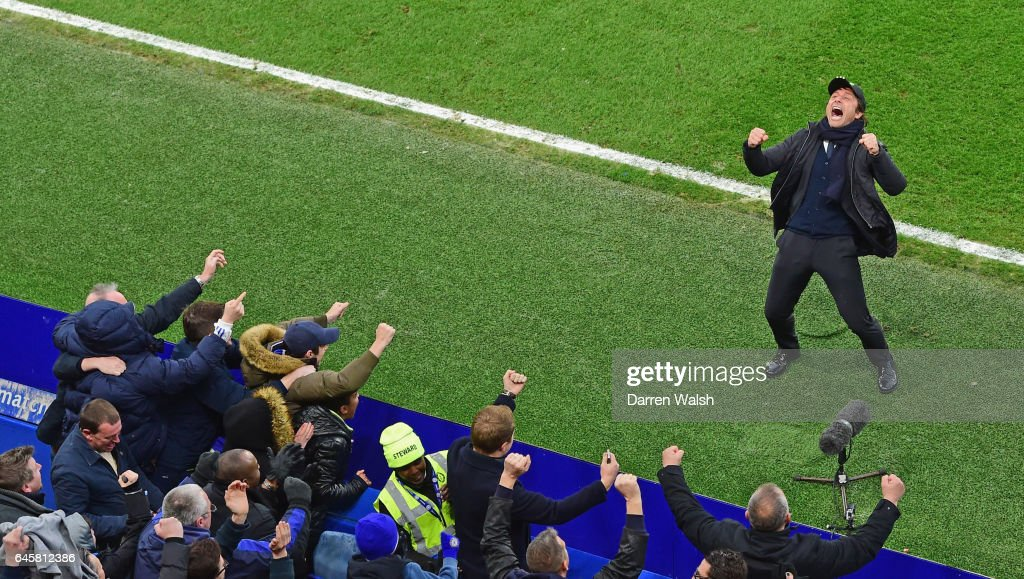 Antonio Conte manager of Chelsea celebrates in front of fans during the Premier League match between Chelsea and Swansea City at Stamford Bridge on February 25, 2017 in London, England.