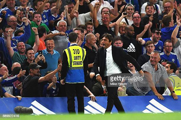Antonio Conte Manager of Chelsea celebrates the goal scored by Diego Costa of Chelsea during the Premier League match between Chelsea and West Ham...