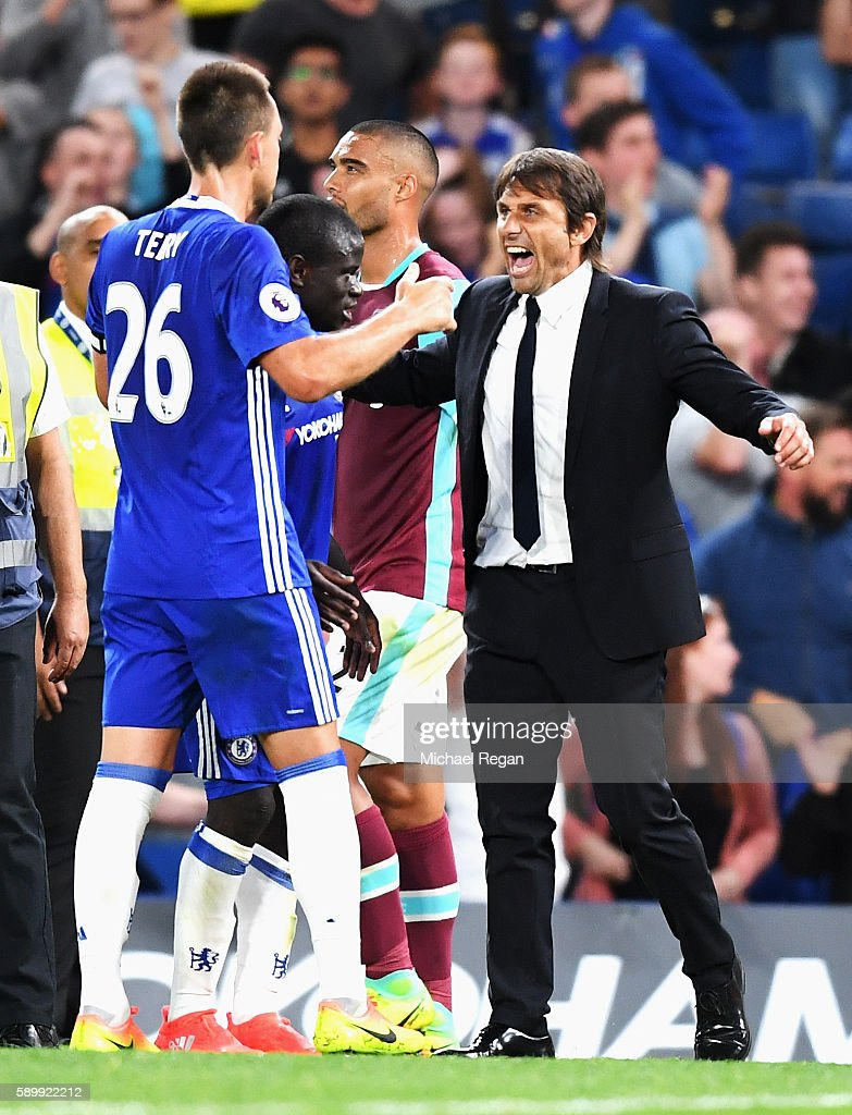 Antonio Conte, Manager of Chelsea celebrates victory with John Terry of Chelsea after the Premier League match between Chelsea and West Ham United at Stamford Bridge on August 15, 2016 in London, England.