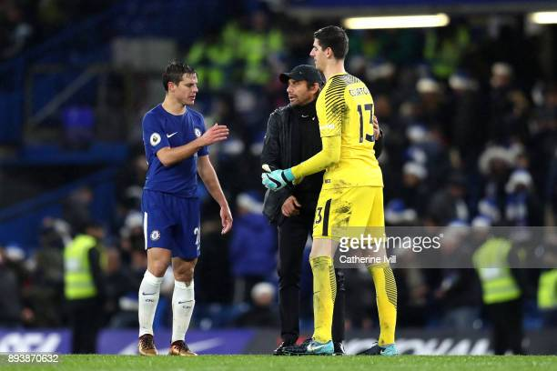 Antonio Conte Manager of Chelsea celebrates victory with Thibaut Courtois of Chelsea and Cesar Azpilicueta of Chelsea after the Premier League match...