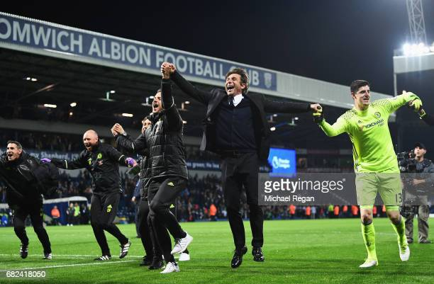 Antonio Conte Manager of Chelsea celebrates winning the leaugue with Thibaut Courtois of Chelsea after the Premier League match between West Bromwich...