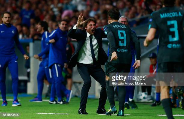 Antonio Conte Manager of Chelsea celebrates with Alvaro Morata of Chelsea after he scores his sides first goal during the UEFA Champions League group...