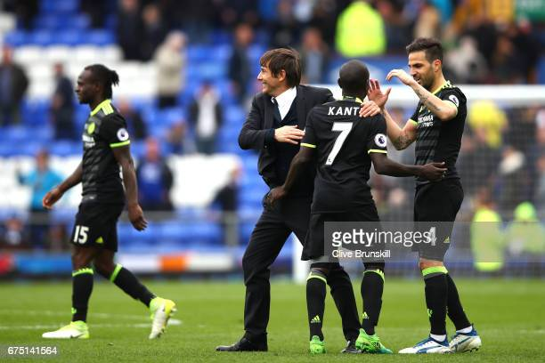 Antonio Conte Manager of Chelsea celebrates with N'Golo Kante of Chelsea and Cesc Fabregas of Chelsea during the Premier League match between Everton...