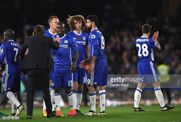 Antonio Conte Manager of Chelsea celebrates with N'Golo Kante of Chelsea after the final whistle during the Premier League match between Chelsea and...