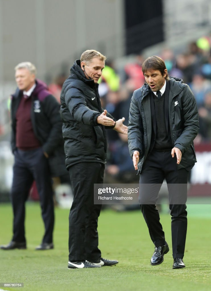 Antonio Conte, Manager of Chelsea confronts the 4th Official during the Premier League match between West Ham United and Chelsea at London Stadium on December 9, 2017 in London, England.