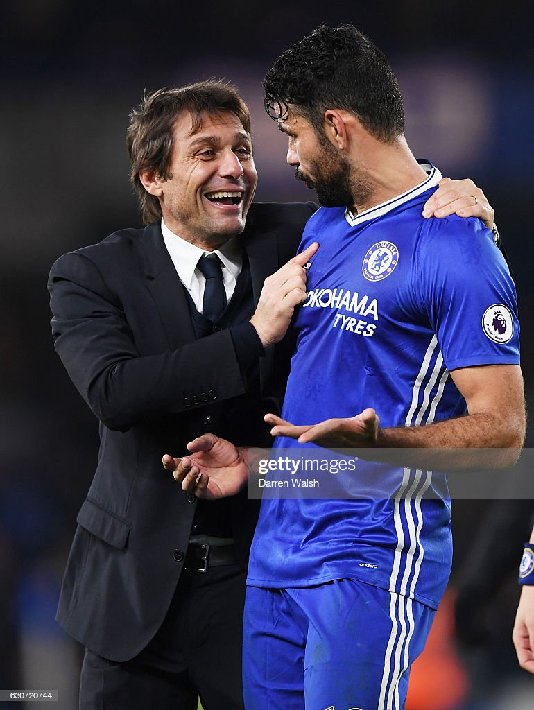 Antonio Conte (L), Manager of Chelsea congratulates Diego Costa (R) after the Premier League match between Chelsea and Stoke City at Stamford Bridge on December 31, 2016 in London, England.