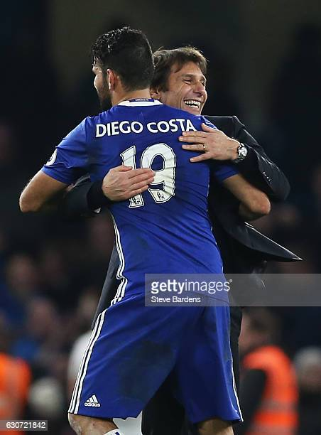 Antonio Conte Manager of Chelsea congratulates Diego Costa after the Premier League match between Chelsea and Stoke City at Stamford Bridge on...